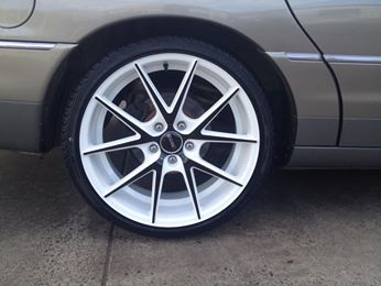 Versus Talon Wheels in a 20x8.5 in white/black/machined on a WH Holden Statesman with 245/30R20 Austyre Tyres. Dog Tyred the place for the best mag and tyre deals.